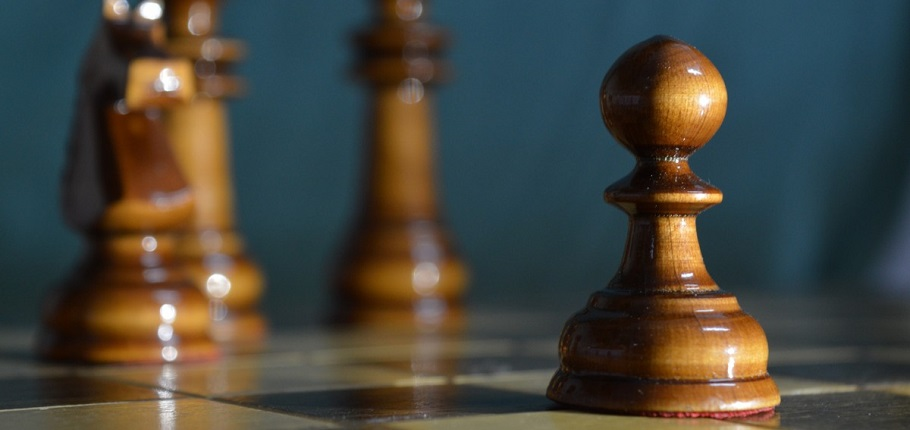 Housing - a pawn on a chess board