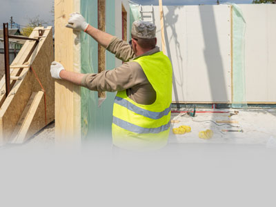 Man building modular buildings