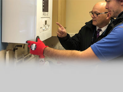 Midland Heart staff providing heating in social housing