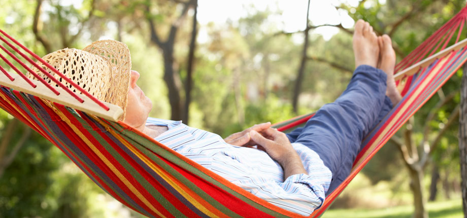 Man lazing in a hammock