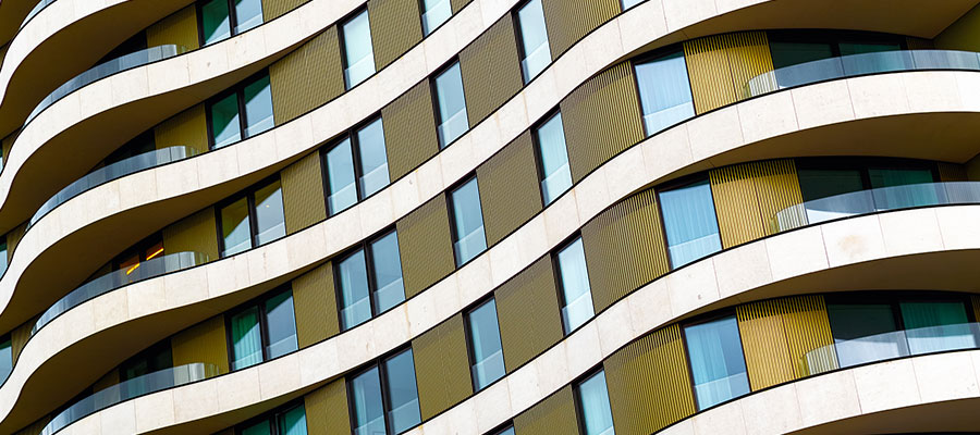 Cladding outside a curved building - Photo: I Wei Huang / Shutterstock.com