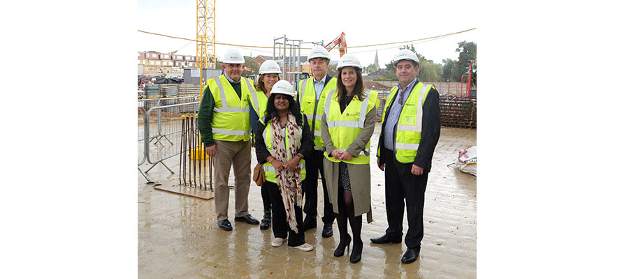 housing developments -  London Borough of Hounslow Councillor and Leader of the Council, Steve Curran; A2Dominion Development Director, Doreen Wright; Hounslow West Cllr, Bandna Chopra; A2Dominion CEO, Darryl Mercer; London Borough of Hounslow Assistant Director of Planning & Development, Sarah Scannell and A2Dominion Development Director, Danny Lynch at the Bath Road construction site.